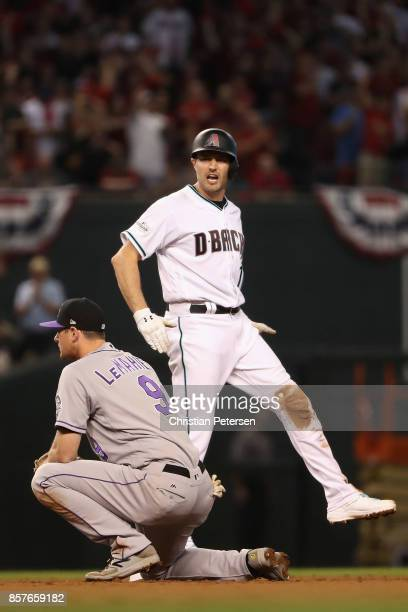 J Pollock of the Arizona Diamondbacks celebrates after hitting a double during the bottom of the first inning of the National League Wild Card game...