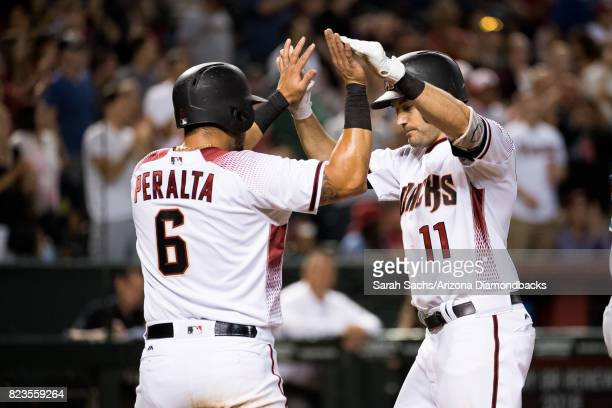 J Pollock of the Arizona Diamondbacks celebrates with teammate David Peralta after hitting a tworun home run during a game against the Atlanta Braves...