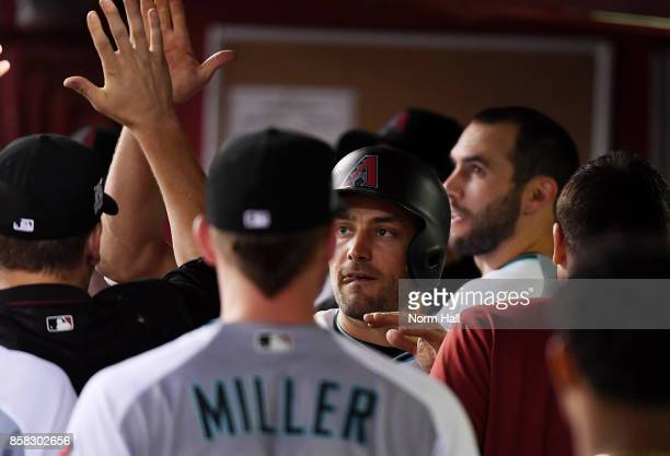 Pollock of the Arizona Diamondbacks celebrates with teammates in the dugout after scoring a run in the eighth inning against the Colorado Rockies...