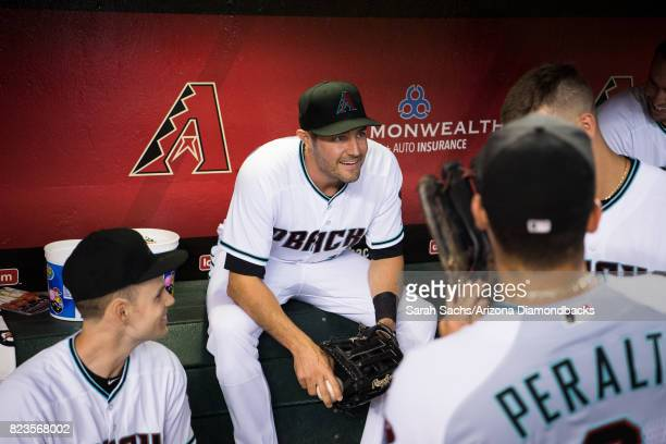 J Pollock of the Arizona Diamondbacks converses with teammates prior to a game against the Atlanta Braves at Chase Field on July 25 2017 in Phoenix...