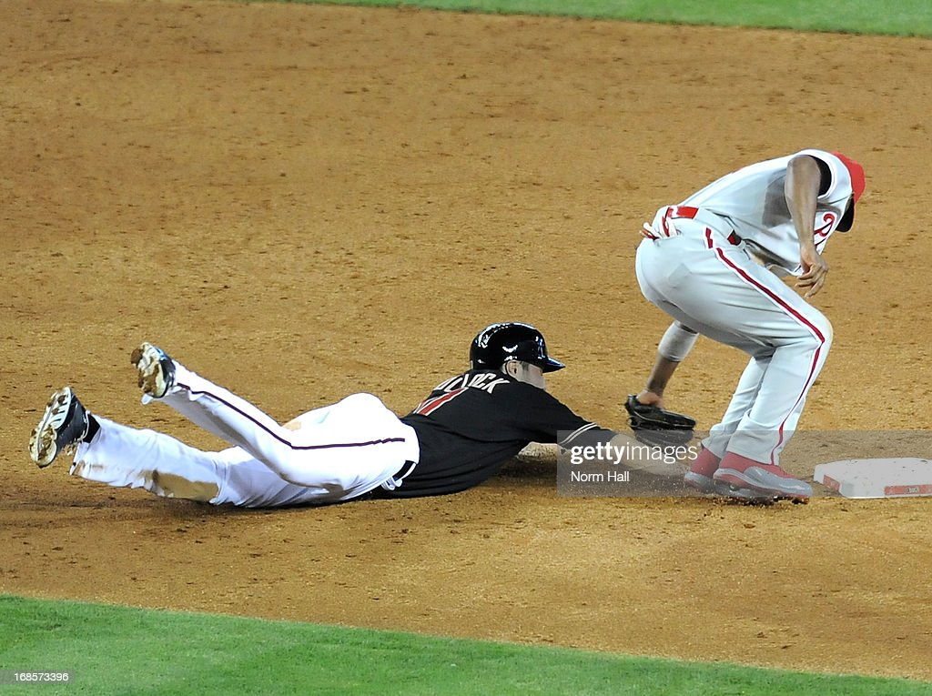 AJ Pollock #11 of the Arizona Diamondbacks dives back to second base while being tagged out by <a gi-track='captionPersonalityLinkClicked' href=/galleries/search?phrase=Jimmy+Rollins&family=editorial&specificpeople=204478 ng-click='$event.stopPropagation()'>Jimmy Rollins</a> #11 of the Philadelphia Phillies at Chase Field on May 11, 2013 in Phoenix, Arizona.