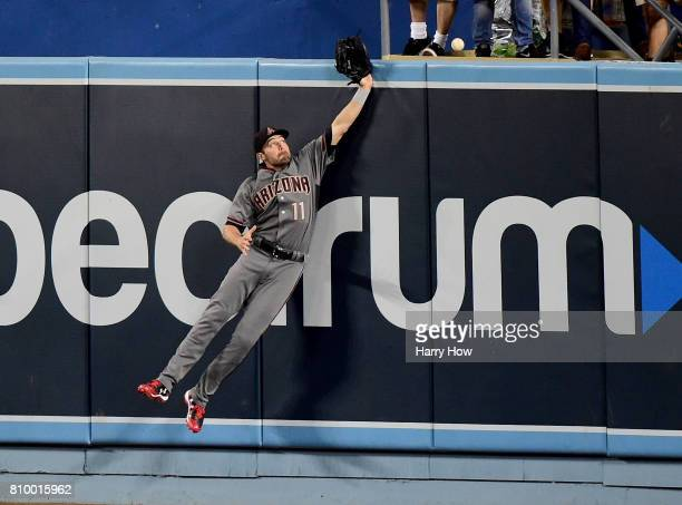 J Pollock of the Arizona Diamondbacks fails to catch a homerun ball from Logan Forsythe of the Los Angeles Dodgers to tie the game 11 during the...