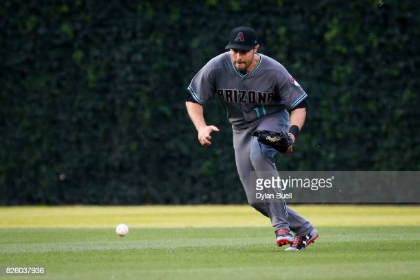 J Pollock of the Arizona Diamondbacks fields a ground ball in the first inning against the Chicago Cubs at Wrigley Field on August 1 2017 in Chicago...