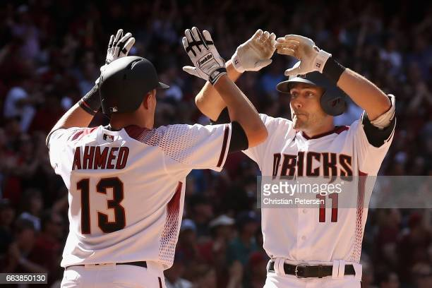 J Pollock of the Arizona Diamondbacks high fives Nick Ahmed after Pollock hit a two run home run against the San Francisco Giants during the sixth...