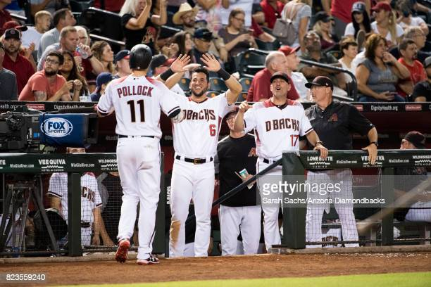 J Pollock of the Arizona Diamondbacks highfives teammates after scoring a run during a game against the Atlanta Braves at Chase Field on July 24 2017...