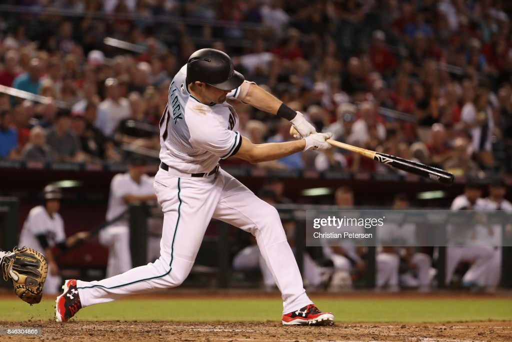 A.J. Pollock #11 of the Arizona Diamondbacks hits a double against the Colorado Rockies during the sixth inning of the MLB game against the Colorado Rockies at Chase Field on September 12, 2017 in Phoenix, Arizona.