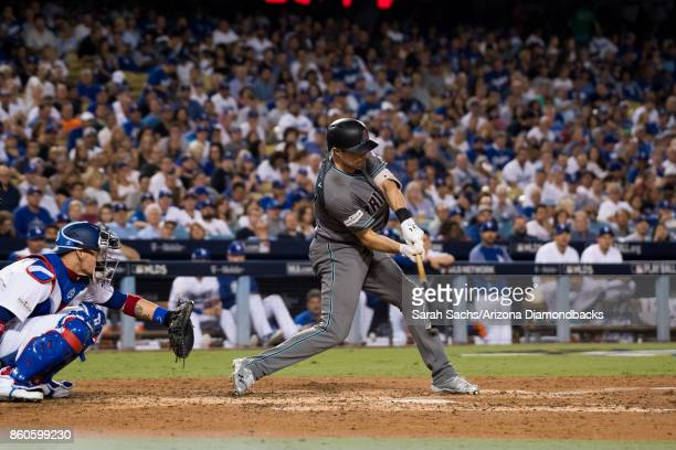 J Pollock of the Arizona Diamondbacks hits a home run during game one of the National League Division Series against the Los Angeles Dodgers at...