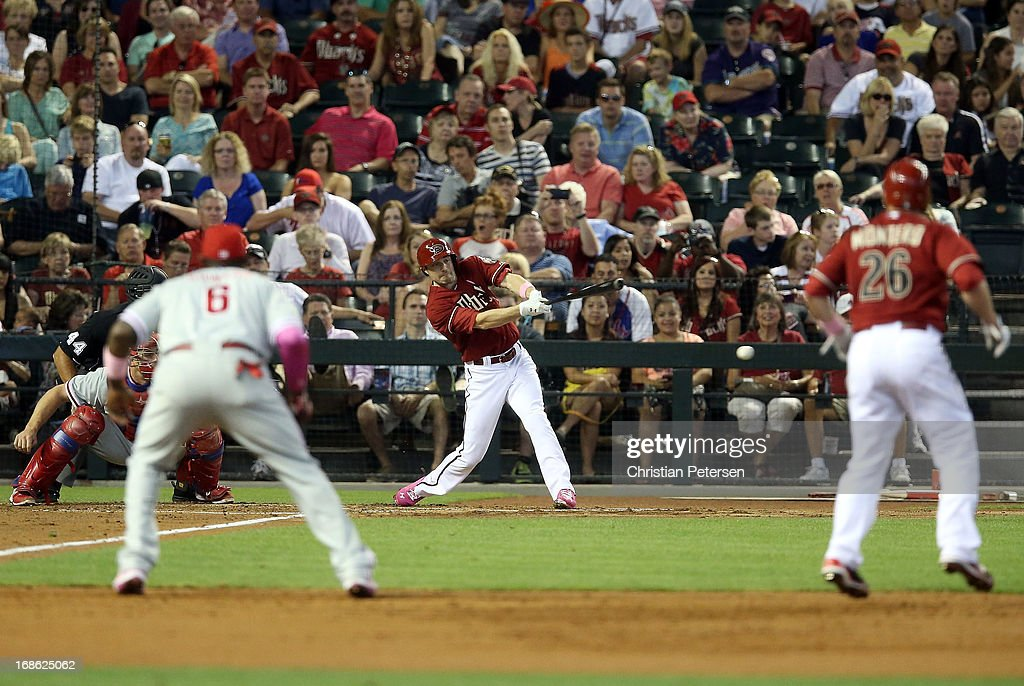 A.J. Pollock #11 of the Arizona Diamondbacks hits a RBI single against the Philadelphia Phillies during the second inning of the MLB game at Chase Field on May 12, 2013 in Phoenix, Arizona.