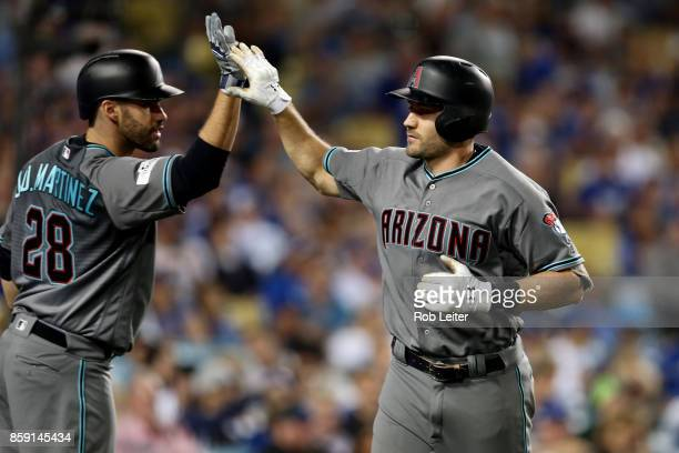 J Pollock of the Arizona Diamondbacks is greeted by JD Martinez after hitting a solo home run during Game 1 of the National League Division Series...