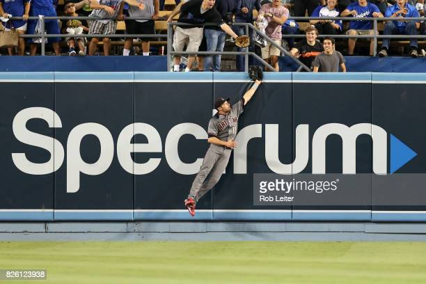 J Pollock of the Arizona Diamondbacks leaps at the wall during the game against the Los Angeles Dodgers at Dodger Stadium on July 6 2017 in Los...