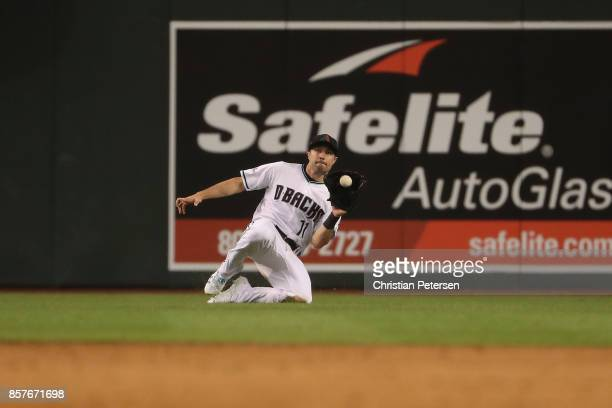 J Pollock of the Arizona Diamondbacks makes a diving catch during the top of the fourth inning of the National League Wild Card game against the...