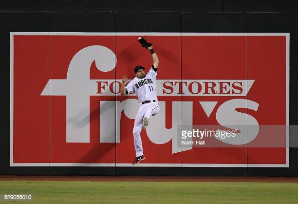 Pollock of the Arizona Diamondbacks makes a leaping catch at the base of the center field wall against the Los Angeles Dodgers at Chase Field on...