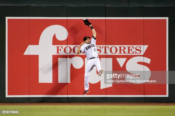 J Pollock of the Arizona Diamondbacks makes a leaping catch during a game against the Los Angeles Dodgers at Chase Field on August 8 2017 in Phoenix...