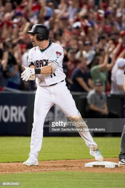 J Pollock of the Arizona Diamondbacks reacts after hitting an RBI triple during the National League Wild Card Game against the Colorado Rockies at...