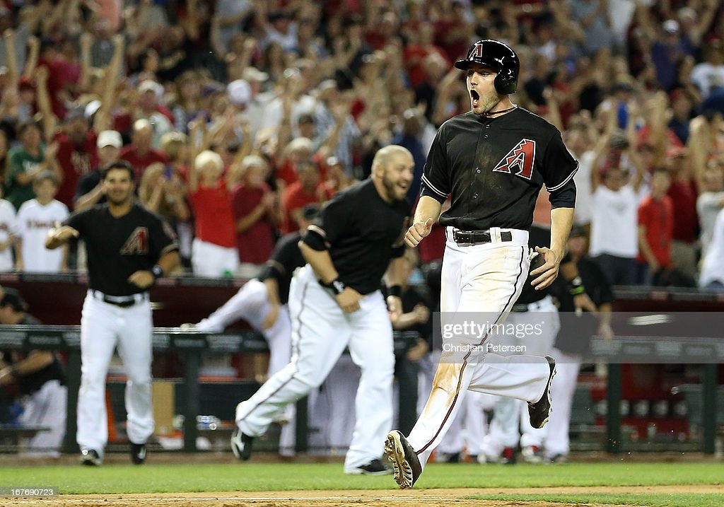 A.J. Pollock #11 of the Arizona Diamondbacks reacts as he scores the winning run on a walk off sacrifice fly hit by Cody Ross (not pictured) in the 10th inning of the MLB game against the Colorado Rockies at Chase Field on April 27, 2013 in Phoenix, Arizona.