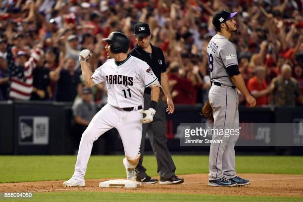 J Pollock of the Arizona Diamondbacks reacts to hitting a tworun triple in the eighth inning during the National League Wild Card against the...