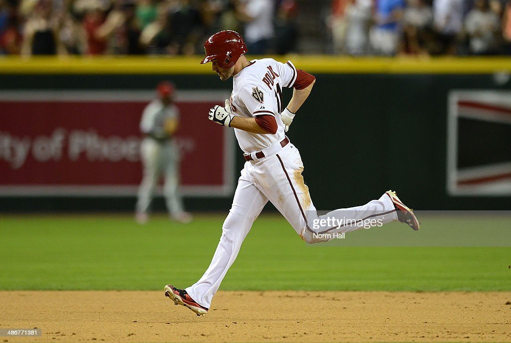 AJ Pollock #11 of the Arizona Diamondbacks rounds second base after hitting a home run in the eighth inning against the Philadelphia Phillies at Chase Field on April 25, 2014 in Phoenix, Arizona. Dbacks won 5-4.