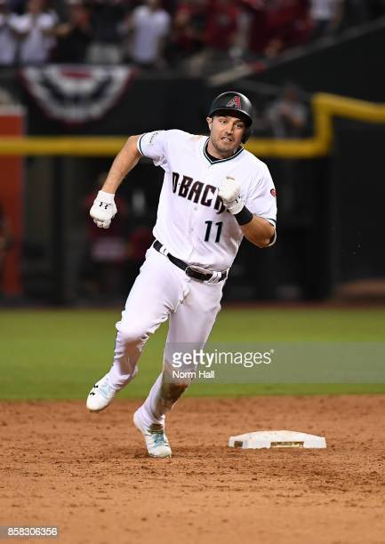 Pollock of the Arizona Diamondbacks rounds second base after hitting a triple in the eighth inning against the Colorado Rockies during the National...
