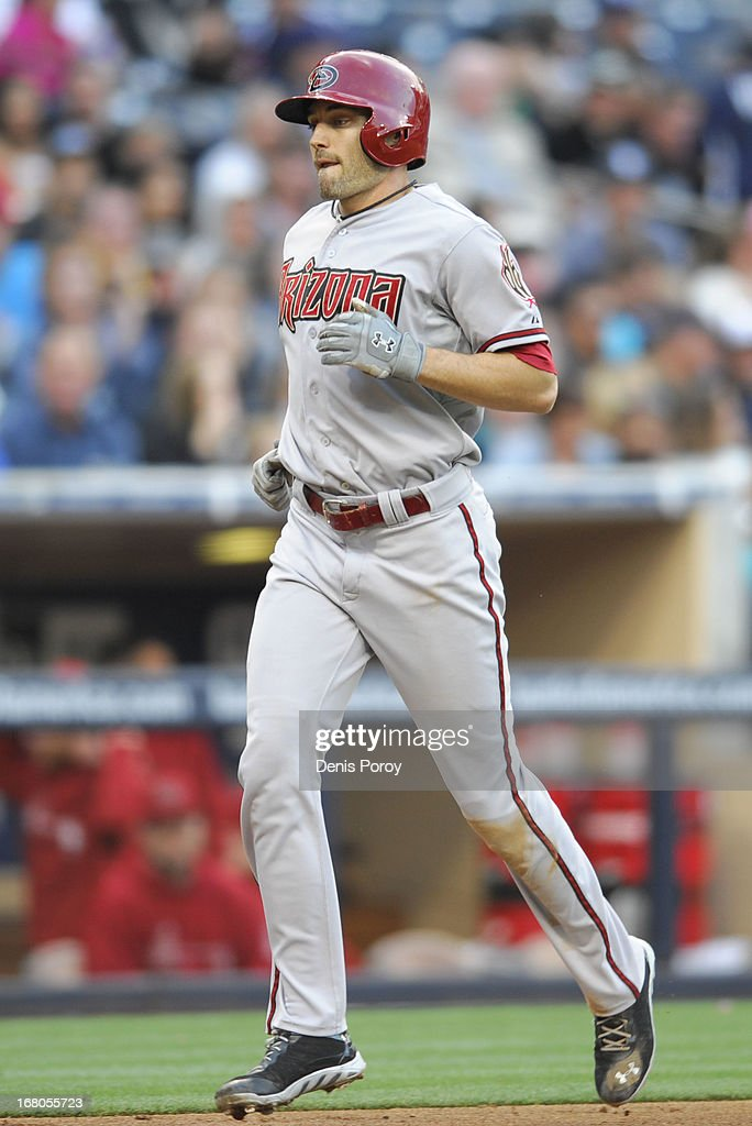 A.J. Pollock #11 of the Arizona Diamondbacks rounds the bases after hitting a solo home run during the fourth inning of a baseball game against the San Diego Padres at Petco Park on May 4, 2013 in San Diego, California.