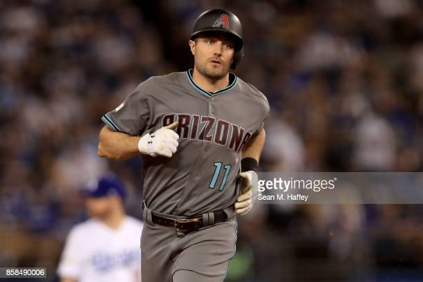J Pollock of the Arizona Diamondbacks rounds the bases after hitting a solo home run in the third inning against the Los Angeles Dodgers in game one...