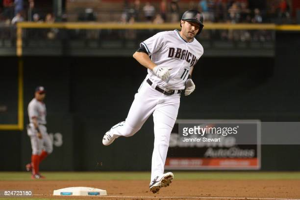 J Pollock of the Arizona Diamondbacks rounds third base after hitting a solo home run against the Washington Nationals in the first inning at Chase...