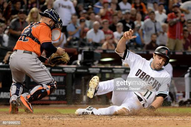J Pollock of the Arizona Diamondbacks safely slides home to score in front of Max Stassi of the Houston Astros in the fifth inning at Chase Field on...