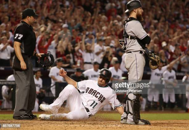 J Pollock of the Arizona Diamondbacks scores a run during the bottom of the eighth inning of the National League Wild Card game against the Colorado...