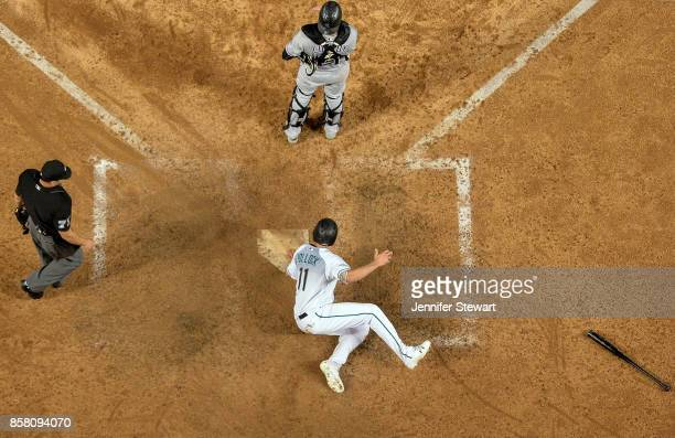 J Pollock of the Arizona Diamondbacks scores a run in the eighth inning during the National League Wild Card against the Colorado Rockies at Chase...