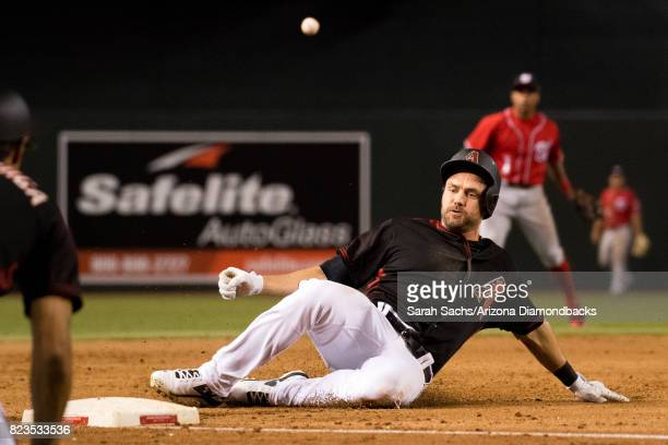 J Pollock of the Arizona Diamondbacks slides into third base on a triple during a game against the Washington Nationals at Chase Field on July 22...