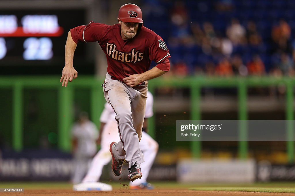 A.J. Pollock #11 of the Arizona Diamondbacks steals third base during the seventh inning of the game against the Miami Marlins at Marlins Park on May 20, 2015 in Miami, Florida. The Diamondbacks set a club record for stolen bases in a single game.