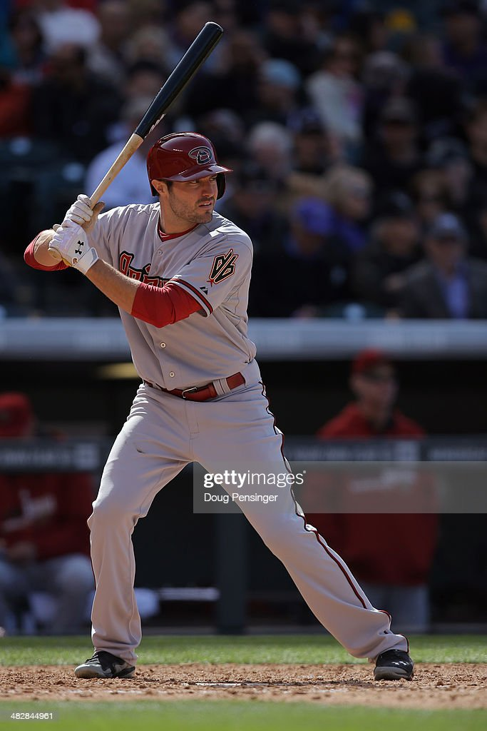 A.J. Pollock #11 of the Arizona Diamondbacks takes an at bat against the Colorado Rockies during the home opener at Coors Field on April 4, 2014 in Denver, Colorado. The Rockies defeated the Diamondbacks 12-2.