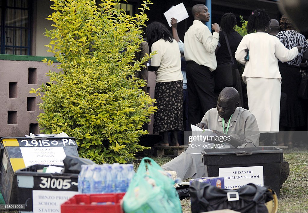Poll-officials check ballot materials collected from Independent Electoral and Boundaries Commission (IEBC) to go to vote offices on March 3, 2013 in Kakamega, on the eve of the Kenyan presidential, gubernatorial and senatorial elections. AFP PHOTO/Tony KARUMBA