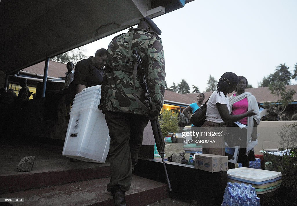 Poll-officials prepares ballot materials collected from Independent Electoral and Boundaries Commission (IEBC) to go to vote offices on March 3, 2013 in Kakamega, on the eve of the Kenyan presidential, gubernatorial and senatorial elections. AFP PHOTO/Tony KARUMBA