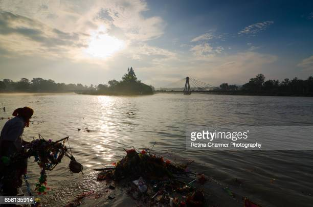 Polluted Ganga & The Statue of Goddess Ganga & Lord Shiva in a river, Ganges River, Haridwar, Uttarakhand, India