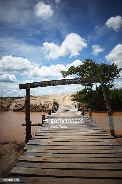 A polluted stream runs past a deforested area used for gold mining in the Amazon lowlands on November 15 2013 in Madre de Dios region Peru The...