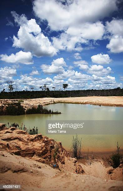 Polluted water sits in a deforested area used for gold mining in the Amazon lowlands on November 15 2013 in Madre de Dios region Peru The...