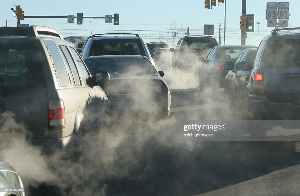 Polluting clouds of exhaust fumes rise in the air