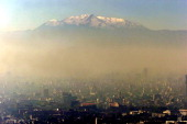 Pollution blankets Mexico city against a backdrop of the Ixtcihuatl volcano 18 January 2002 In Mexico City more than 60 000 people died each year...