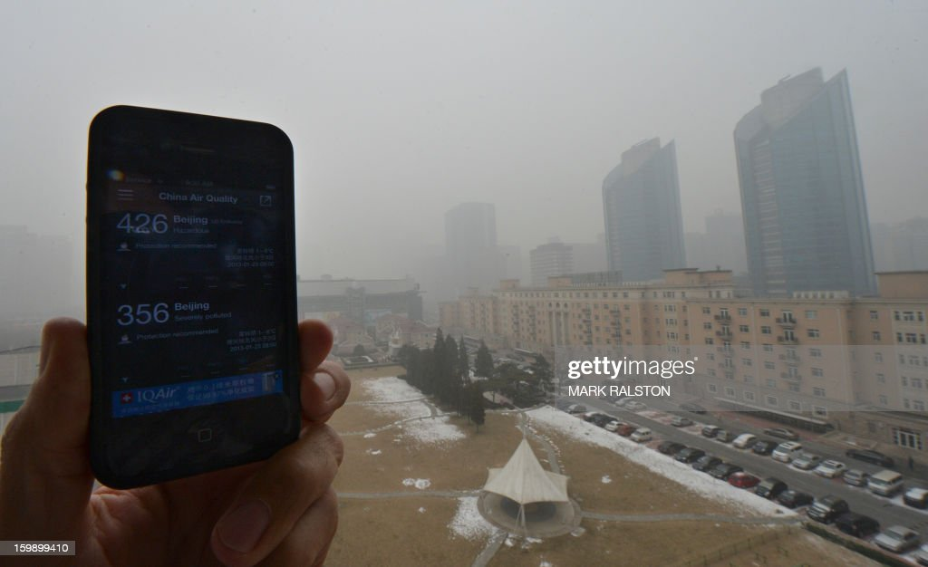 Pollution readings from the US Embassy (upper) and the local government shows hazardous levels of air pollution in Beijing on January 23, 2013. China's capital Beijing will strengthen measures to combat pollution, amid public anger over the dangerous air quality in the sprawling metropolis. At the height of recent pollution, Beijing authorities said readings for PM2.5 -- particles small enough deeply to penetrate the lungs -- hit 993 micrograms per cubic metre, almost 40 times the World Health Organisation's safe limit. AFP PHOTO/Mark RALSTON