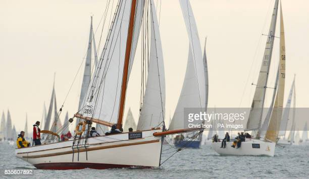 Polly Agatha a Bristol Pilot Cutter heads off the start line in light winds as they compete in the during the JP Morgan Asset Management Round the...