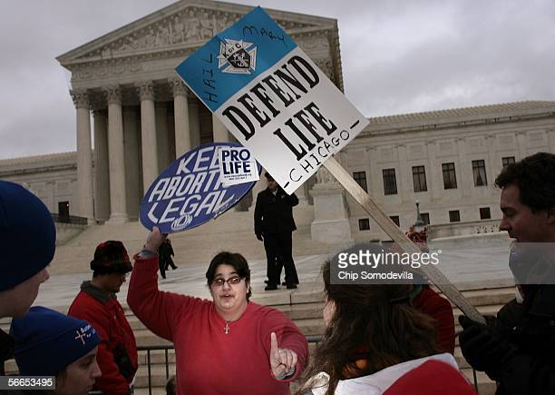 Polly Aris Stamatopoulos of Washington DC debates with Jessica Michaud of Baltimore MD in front of the Supreme Court during the March for Life to...