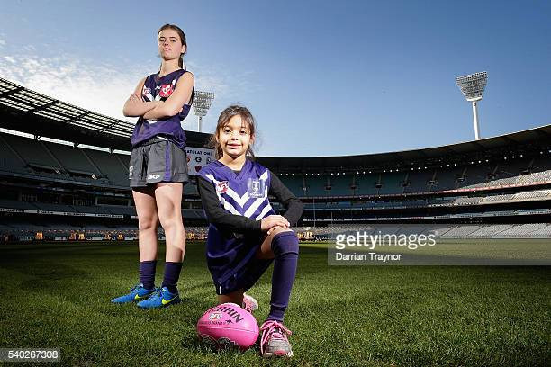 Polly Green and Zara Lilburne pose for a photo wearing the Fremantle Dockers jumpers during an AFL media opportunity to announce the competing teams...