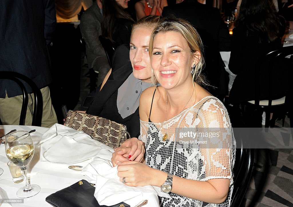 (MANDATORY CREDIT PHOTO BY DAVE M BENETT/GETTY IMAGES REQUIRED) Polly Morgan (L) and Sara Parker-Bowles attend the Harper's Bazaar Women of the Year Awards 2012, in association with Estee Lauder, Harrods and Tiffany & Co., at Claridge's Hotel on October 31, 2012 in London, England.