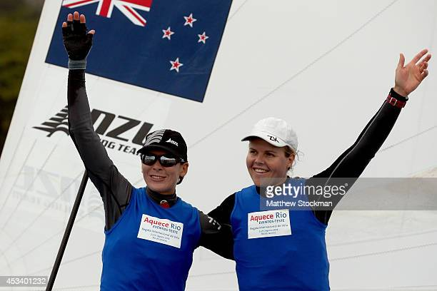 Polly Powrie and Jo Aleh of New Zealand pose for photographers after winning the Women's 470 competition as part of the Aquece Rio International...