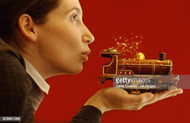 Polly Roberts of Lyon Turnbull blowing off the dust from a Hornby train A major collection of Hornby trains is due to go under the hammer and...