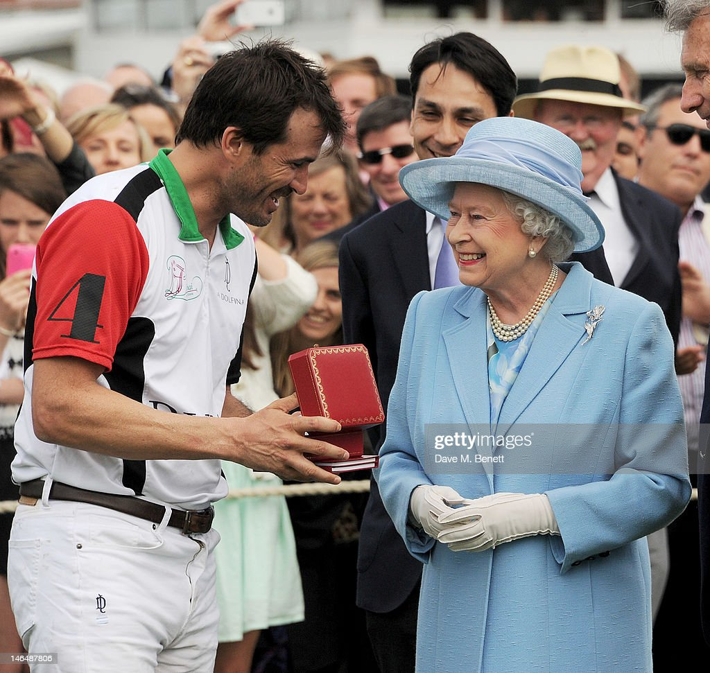 Polo player Adolfo Cambiaso (L) and Queen <a gi-track='captionPersonalityLinkClicked' href=/galleries/search?phrase=Elizabeth+II&family=editorial&specificpeople=67226 ng-click='$event.stopPropagation()'>Elizabeth II</a> attend the Cartier Queen's Cup Polo Day 2012 at Guards Polo Club on June 17, 2012 in Egham, England.