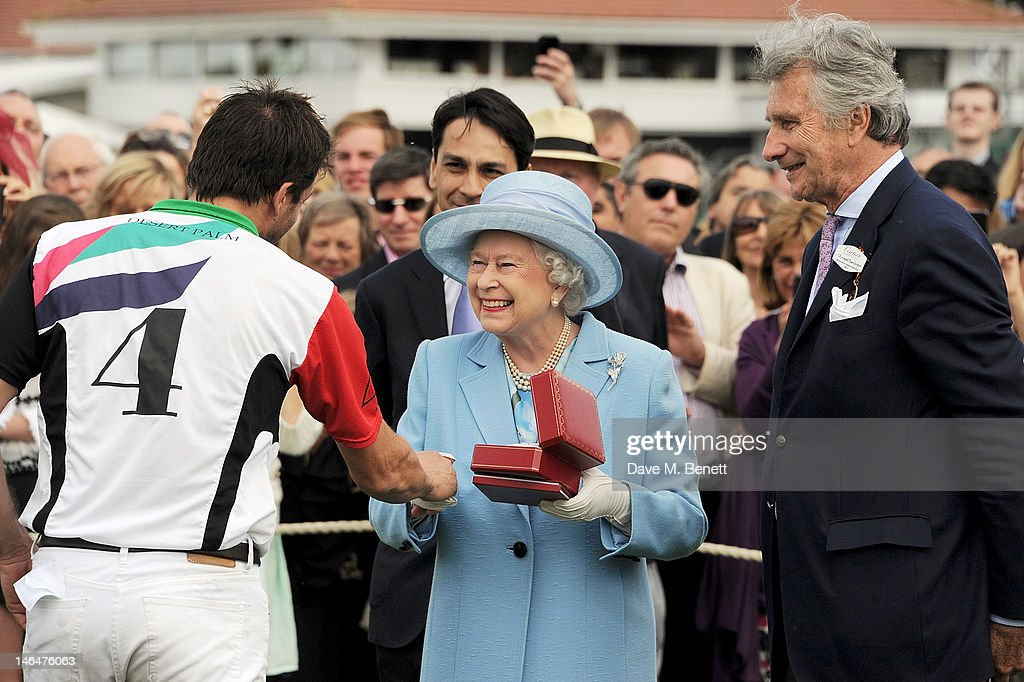 Polo player Adolfo Cambiaso, Cartier Managing Director Francois Le Troquer, Queen <a gi-track='captionPersonalityLinkClicked' href=/galleries/search?phrase=Elizabeth+II&family=editorial&specificpeople=67226 ng-click='$event.stopPropagation()'>Elizabeth II</a> and Executive Chairman of Cartier UK <a gi-track='captionPersonalityLinkClicked' href=/galleries/search?phrase=Arnaud+Bamberger&family=editorial&specificpeople=227439 ng-click='$event.stopPropagation()'>Arnaud Bamberger</a> attend the Cartier Queen's Cup Polo Day 2012 at Guards Polo Club on June 17, 2012 in Egham, England.
