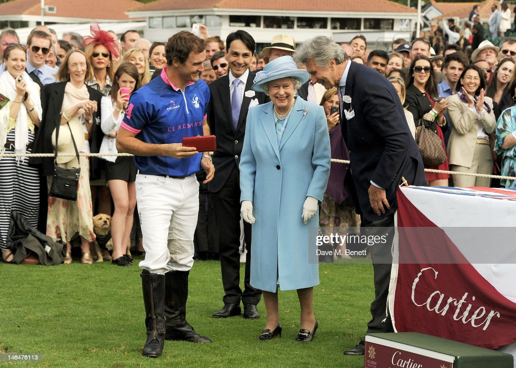 A polo player is congratulated by Cartier Managing Director Francois Le Troquer, Queen <a gi-track='captionPersonalityLinkClicked' href=/galleries/search?phrase=Elizabeth+II&family=editorial&specificpeople=67226 ng-click='$event.stopPropagation()'>Elizabeth II</a> and Executive Chairman of Cartier UK <a gi-track='captionPersonalityLinkClicked' href=/galleries/search?phrase=Arnaud+Bamberger&family=editorial&specificpeople=227439 ng-click='$event.stopPropagation()'>Arnaud Bamberger</a> attend the Cartier Queen's Cup Polo Day 2012 at Guards Polo Club on June 17, 2012 in Egham, England.