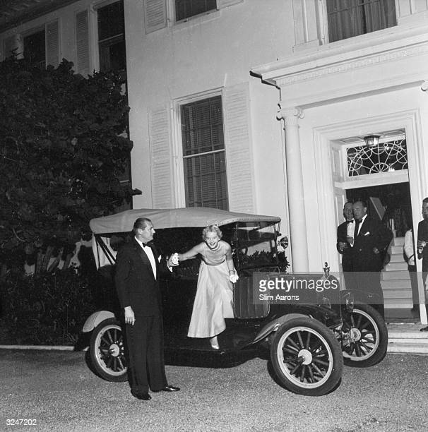 Polo player Winston FC Guest helps his second wife CZ Guest out of their car circa 1960