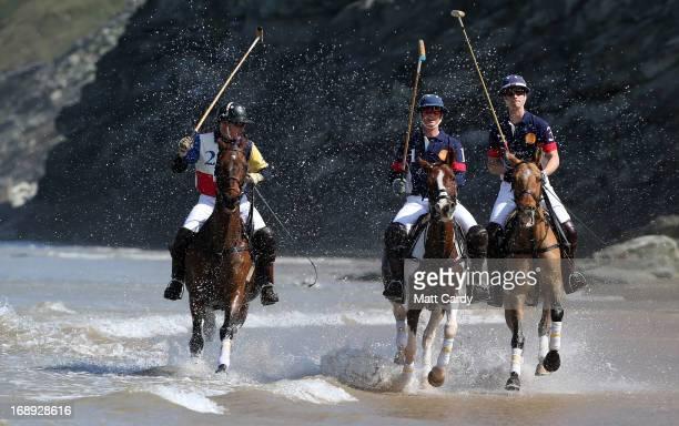 Polo players Andy Burgess riding his horse Shrivar Rob Brockett riding Colorada and Major Ben Marshall riding Chico practice for the beach polo...
